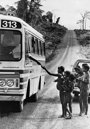 26th March 1964: Members of the Krain-a-Kores tribe in Brazil investigating a bus on the road which passes through their territory. Only recently introduced to Western civilisation, people of the tribe often beg sweets from passengers. (Photo by Keystone Features/Getty Images)